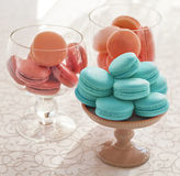 Macarons glass bowl on white background. Delicious sweet buffet with colorful glass bowl of macarons Stock Photos