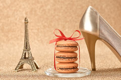 Macarons. Luxury shiny shoes, Eiffel Tower on gold Stock Image