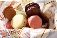 Macarons. Many macaron cakes served in a napkin Royalty Free Stock Photos