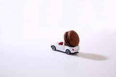 Macarons in a miniature car Royalty Free Stock Image