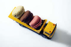 Macarons in a miniature car Royalty Free Stock Photo