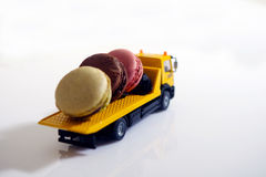 Macarons in a miniature car Royalty Free Stock Photos