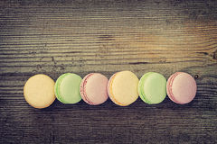 Macarons on  old wooden background Royalty Free Stock Images