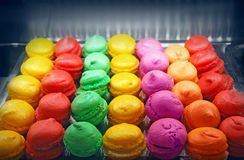 Macaroons in the oven. Multicolor macarons cooking in the oven Royalty Free Stock Photo