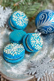 Macarons with a pattern of snowflakes. Royalty Free Stock Image