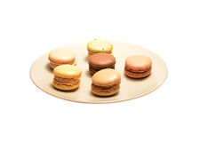 Macarons on a plate. Six macarons on a plate isolated on a white background Stock Images