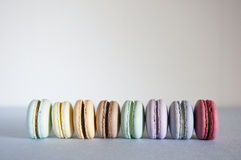 Macarons in a row. Stock Photo
