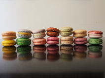 Fourteen colourful French macaron cookies Stock Photography