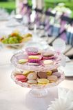 Macarons at the served festive table Royalty Free Stock Image