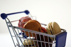 Macarons in a shopping cart Stock Images