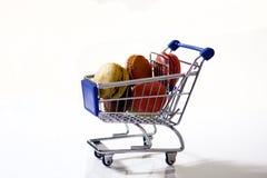 Macarons in a shopping cart. Macarons in a blue shopping cart Stock Photography
