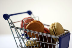 Macarons in a shopping cart Stock Photography