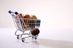 Macarons in a shopping cart Royalty Free Stock Photos