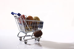 Macarons in a shopping cart. Blue shopping cart full of macarons Stock Photos