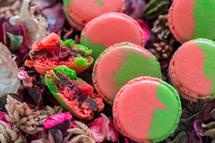 Macarons stuffed with chocolate and berries. Royalty Free Stock Photos