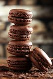 Macarons sweet chocolate macaron French on wooden table Royalty Free Stock Image