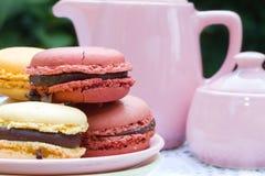 Macarons and teapot Stock Photos