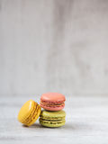 Macarons in three colors Stock Photos