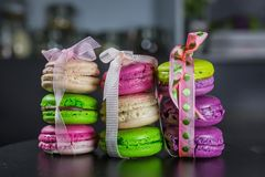 Macarons tied with ribbons of three pieces, a French dessert, gifts for the holiday stock photography