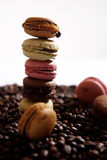 Macarons tower. Tower built by macaron cakes and some coffee beans on background Stock Images