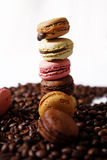 Macarons tower. Many macarons among a bunch of coffee beans Stock Image