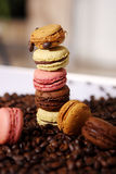 Macarons tower. Many macarons among a bunch of coffee beans Royalty Free Stock Photo