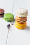 Macarons on white wooden background. Macarons stack on white wooden background royalty free stock image