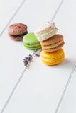 Macarons on white wooden background. Macarons stack on white wooden background royalty free stock photography
