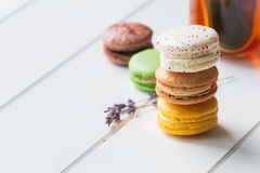 Macarons on white wooden background. Macarons stack with tea on white wooden background stock photography