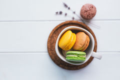 Macarons on white wooden background Royalty Free Stock Image