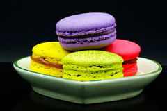 Macaroon. Assortment of colorful macaroons on a small green ceramic plate stock photos