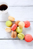 Macaroon with coffee on the boards Stock Photo