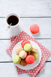 Macaroon and coffee on white boards Stock Image