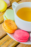 Macaroon. Colorful macaroon with white cup tea Stock Photos