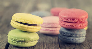 Macaroon colorful on the wooden floor. With vintage Royalty Free Stock Image