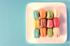 Macaroon cookies. From abovein the plate,selective focus and blank space on left side for text Royalty Free Stock Photo