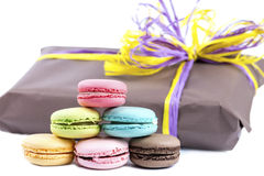 Macaroon cookies on background gift box, isolated on white backg Stock Images