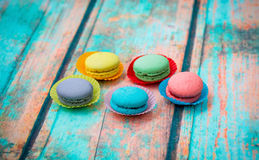 Macaroon cookies on blue wooden table Stock Photography