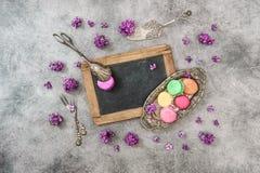 Macaroon cookies lilac flowers. Vintage cutlery chalkboard Royalty Free Stock Images
