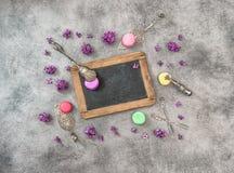Macaroon cookies lilac flowers. Vintage kitchen utensils Stock Image