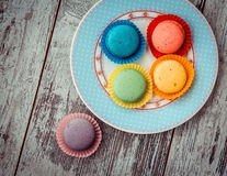 Macaroon cookies on plate above view Royalty Free Stock Photography
