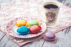 Macaroon cookies on plate on wooden gray table Royalty Free Stock Image