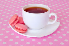 macaroon and a cup of black tea Stock Images