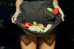 Macaroon dessert in the hands of women Stock Photos