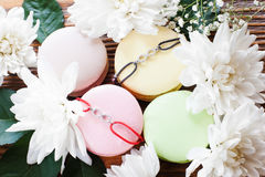 Macaroon french cookies with best friend bracelets Stock Photo