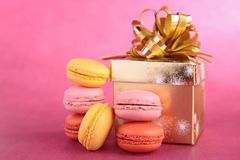 Macaroon and gift box Stock Images