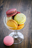 Macaroon in a glass vase Stock Photos