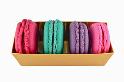 Macaroon in gold paper box isolated Stock Photography