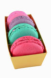 Macaroon in gold paper box isolated Royalty Free Stock Image