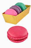 Macaroon in gold paper box isolated Stock Photos